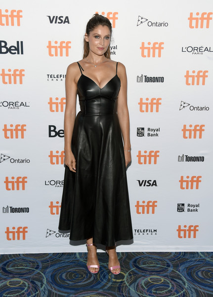 Laetitia Casta looked alluring in a low-cut black leather dress by Dior at the TIFF premiere of 'A Faithful Man.'