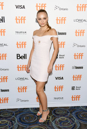 Lily-Rose Depp looked sophisticated in an off-the-shoulder tweed mini dress by Chanel at the TIFF premiere of 'A Faithful Man.'