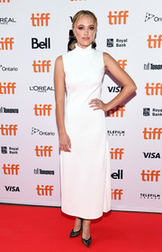 Maika Monroe styled her hair with lacy black pumps.