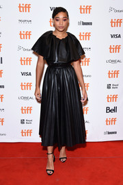 Amandla Stenberg went for edgy elegance in a pleated black leather dress by Huishan Zhang at the TIFF premiere of 'Where Hands Touch.'