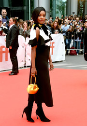 Gabrielle Union brightened up her monochrome outfit with a yellow satin purse by Gabriela Hearst for the TIFF premiere of 'The Public.'