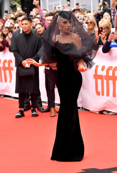 Lady Gaga brought plenty of drama to the TIFF premiere of 'A Star is Born' with this veiled black velvet gown by Armani Prive.