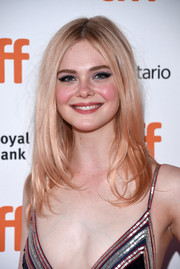 For her beauty look, Elle Fanning went bold with a smoky cat eye.