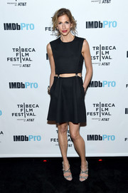 Alysia Reiner styled her dress with silver crisscross-strap sandals.