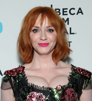 Christina Hendricks brightened up her pretty face with a swipe of hot-pink lipstick.