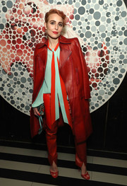 Underneath her coat, Noomi Rapace was bold in red leather pants and a color-block pussybow blouse, both by Givenchy.