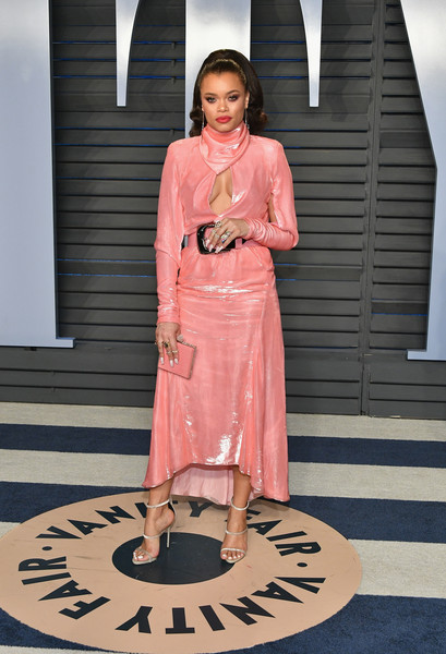 Andra Day was a perfect blend of sexy and sweet in a cleavage-baring pink midi dress by Nina Ricci at the 2018 Vanity Fair Oscar party.