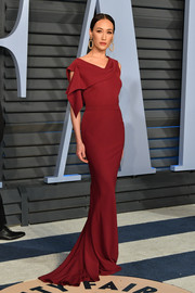 Maggie Q chose an asymmetrical red fishtail gown for the 2018 Vanity Fair Oscar party.