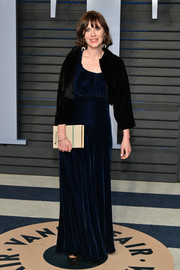 Zooey Deschanel chose a classic navy velvet gown for the 2018 Vanity Fair Oscar party.