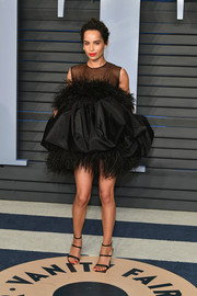Zoe Kravitz donned a not-so-basic LBD by Saint Laurent, featuring a puffy silhouette and feather embellishments, for the 2018 Vanity Fair Oscar party.