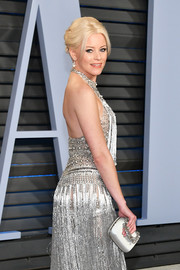 Elizabeth Banks went for high shine with this silver Roger Vivier satin purse paired with an embellished dress at the 2018 Vanity Fair Oscar party.