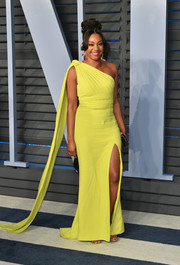 Tiffany Haddish looked exuberant in a neon-yellow one-shoulder gown by Brandon Maxwell at the 2018 Vanity Fair Oscar party.