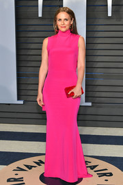 Alicia Silverstone brought a bold pop of color to the 2018 Vanity Fair Oscar party with this hot-pink turtleneck gown by Christian Siriano.