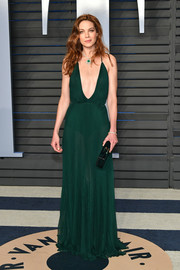 Michelle Monaghan worked an emerald Reem Acra gown with a down-to-the-navel neckline at the 2018 Vanity Fair Oscar party.