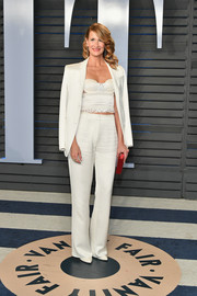 Laura Dern worked an all-white Gabriela Hearst suit and La Perla bustier ensemble at the 2018 Vanity Fair Oscar party.