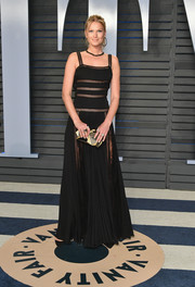 Toni Garrn went for bohemian glamour in a black Elie Saab gown with sheer inserts at the 2018 Vanity Fair Oscar party.