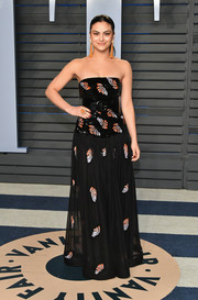 Camila Mendes donned an embellished strapless gown by Armani for the 2018 Vanity Fair Oscar party.