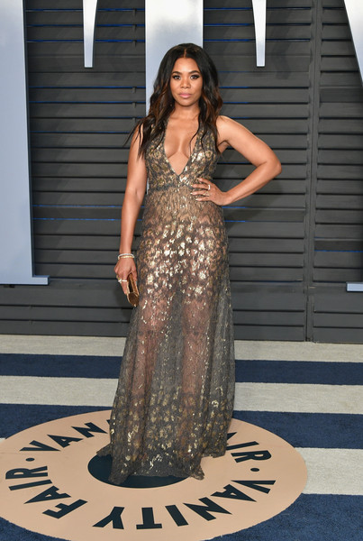 Regina Hall put some skin on display in a sheer gray and gold gown by Tadashi Shoji at the 2018 Vanity Fair Oscar party.