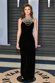 Emma Watson looked opulent in a black Ralph Lauren velvet gown with beaded bib detailing at the 2018 Vanity Fair Oscar party.