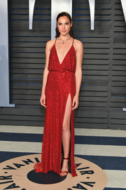 Gal Gadot looked totally alluring in a red Armani Prive gown with a draped bodice and all-over micro beading at the 2018 Vanity Fair Oscar party.