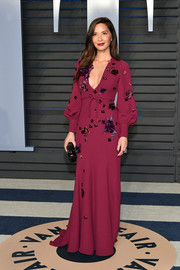 Olivia Munn looked enchanting in a flower-appliqued burgundy gown by Andrew Gn at the 2018 Vanity Fair Oscar party.