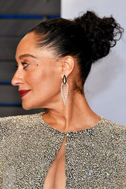 Tracee Ellis Ross pulled her hair back into a braided bun for the 2018 Vanity Fair Oscar party.