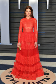 Marisa Tomei looked fetching in a long-sleeve red lace-panel gown by Valentino at the 2018 Vanity Fair Oscar party.