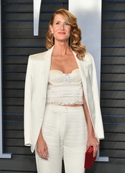 Laura Dern punctuated her white look with a red box clutch by Roger Vivier.