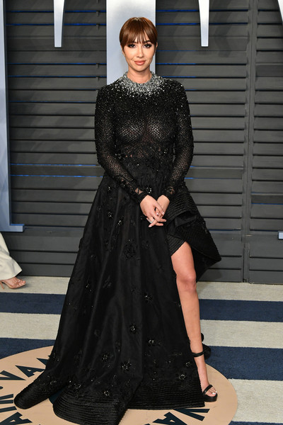 Jackie Cruz looked subtly sexy in a partially sheer, crystal-adorned black gown by Tony Ward Couture at the 2018 Vanity Fair Oscar party.