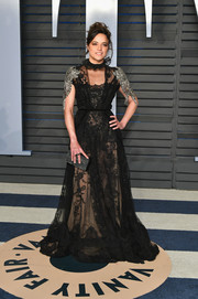Michelle Rodriguez was sexy-goth in a sheer black Reem Acra gown with embellished sleeves at the 2018 Vanity Fair Oscar party.