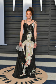 Sasha Lane worked an artsy print gown by Dior at the 2018 Vanity Fair Oscar party.