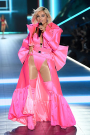 Bebe Rexha finished off her bodysuit with a long pink coat.
