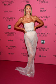 Candice Swanepoel flaunted her enviable figure in a sheer strapless gown by Khyeli Couture at the 2018 Victoria's Secret after-party.