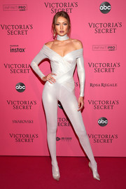 Gigi Hadid showed off her supermodel figure in an off-the-shoulder catsuit by Atelier Versace at the 2018 Victoria's Secret after-party.