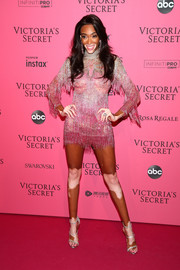 Winnie Harlow looked disco-ready in a fringed pink mini dress by Dundas at the 2018 Victoria's Secret after-party.