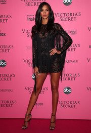 Lais Ribeiro complemented her dress with black triple-strap sandals by Giuseppe Zanotti.