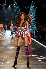 Cindy Bruna mixed her plaids with this lingerie, belt, and wings combo at the 2018 Victoria's Secret show.