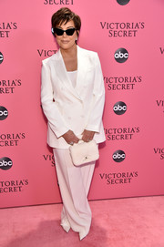 Kris Jenner looked pristine in a white double-breasted pantsuit at the 2018 Victoria's Secret fashion show.
