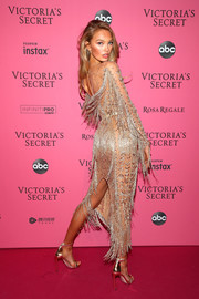 Romee Strijd gave us some fringe action with this gold Zuhair Murad Couture number at the 2018 Victoria's Secret after-party.