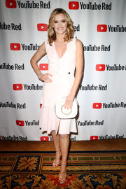 Missi Pyle paired her dress with gold triple-strap sandals.