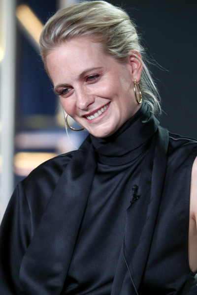 Poppy Delevingne swept her hair back into a loose updo for the 2018 Winter TCA Tour.