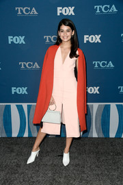 For her footwear, Sofia Black-D'Elia chose a pair of white bootie mules by Stuart Weitzman.