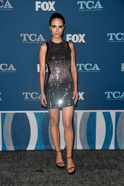 Black sandals with skinny straps and chunky platforms completed Jordana Brewster's look.