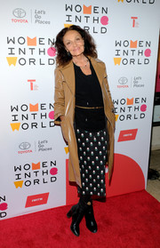 Underneath her coat, Diane von Furstenberg sported a printed pencil skirt and a black cowl-neck top.