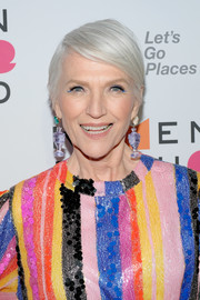 Maye Musk attended the 2018 Women in the World Summit wearing a short side-parted style.