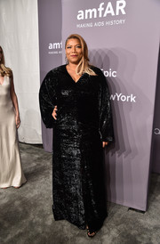 Queen Latifah shimmered in a long-sleeve black sequin gown at the 2018 amfAR Gala New York.