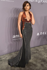 Taraji P. Henson ravished in a plunging David Koma halter gown with metallic embellishments at the 2018 amfAR Gala New York.