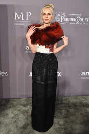 Andreja Pejic donned a beaded black, white, and red gown by Oscar de la Renta for the 2018 amfAR Gala New York.