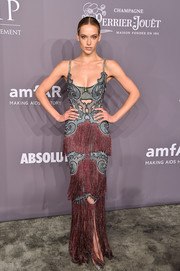 Hannah Ferguson looked romantic, sexy, and glamorous all at once in a fringed red and blue gown by Raisa & Vanessa at the 2018 amfAR Gala New York.