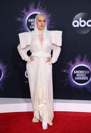 Christina Aguilera looked every bit the glamorous diva in a hooded white gown by Jean Paul Gaultier Couture at the 2019 American Music Awards.